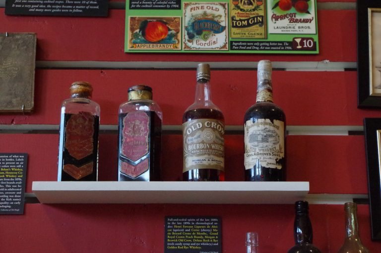 antique bourbon bottles at the Museum of the American Cocktail