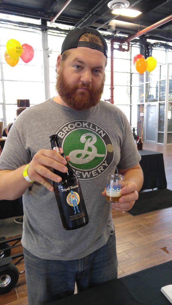 T.J. Smolka of Brooklyn Brewing pours a Triple Burner
