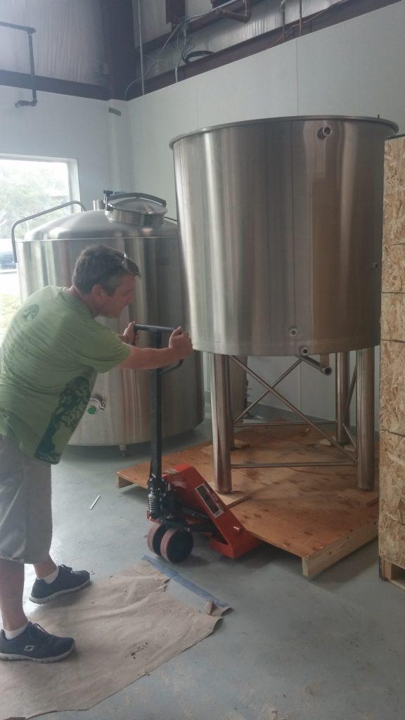 Big Beach Head Brewer Rod Murray installing new brewing system