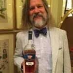 Colorful personality Jared Brown graciously offering a taste of his Havana Club rum! Photo by Adam Levy