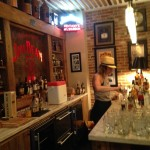 Breier mixes Old Fashioneds in the Man Cave