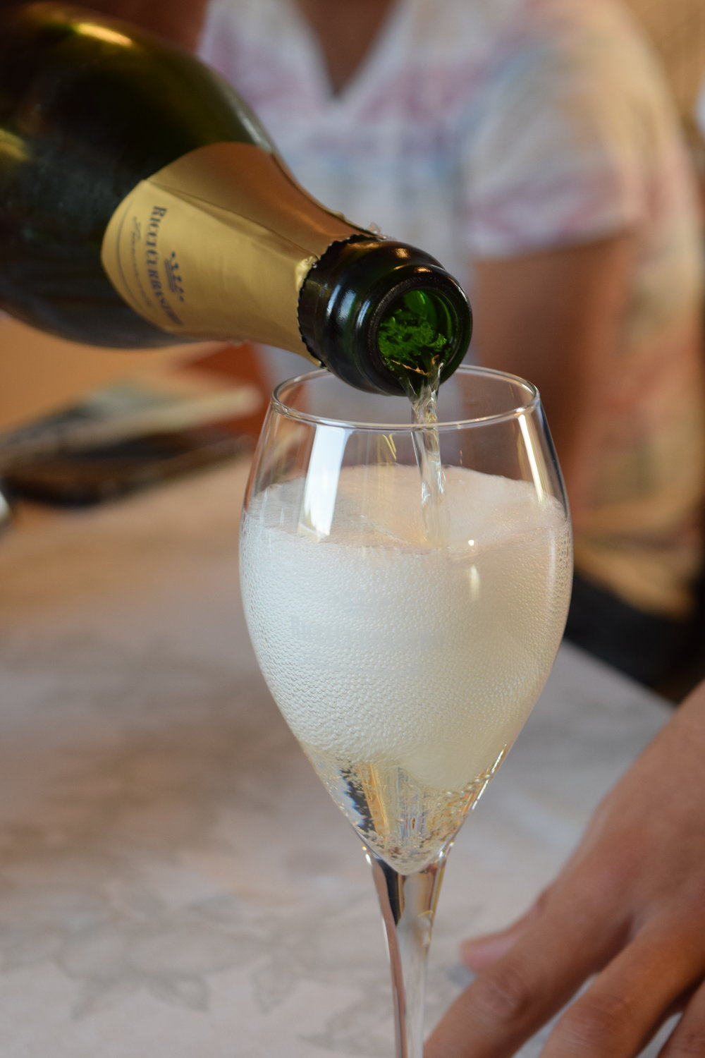 pouring Franciacorta, photo by Becca Yeamans Irwin
