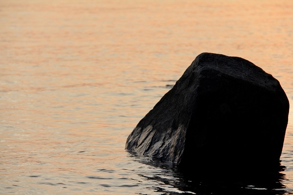 Big rock in shallow water.jpg