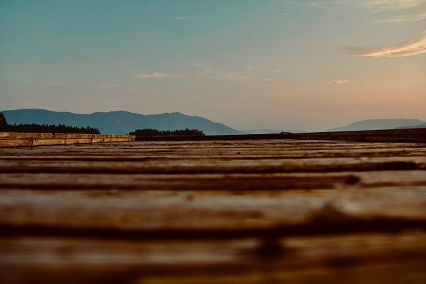 A dock at eye level with mountains, sunset.jpg