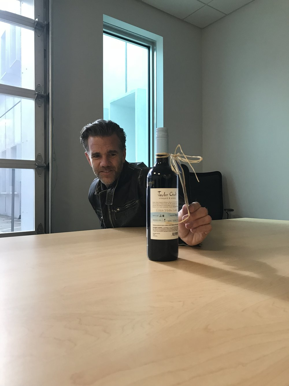 Matthew Chan wanted to give each of the executives he met with at Tesla a bottle of our 2016 Estate Norton wine since it's sustainably-grown on-site in our vineyard. Here, he presented our wine to Franz von Holzhausen, Chief Designer at Tesla.