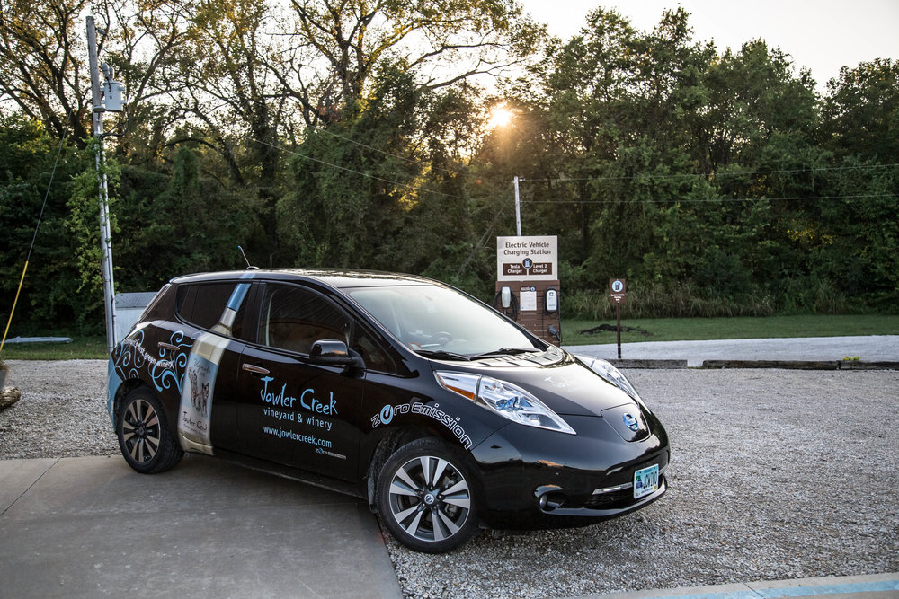 Jowler Creek sustainable and green winery uses sustainable practices to make its award-winning, delicious wine. The winery has an electric vehicle charger and drives a sustainable Nissan Leaf to Kansas City and St. Joseph to run errand.