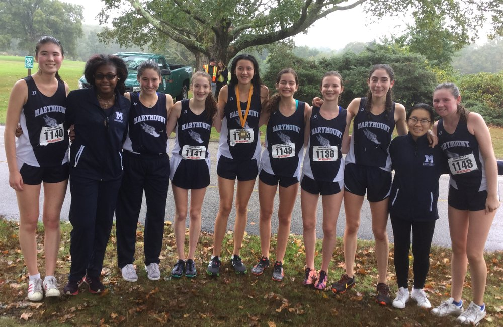 Varsity Cross Country members pose for a picture after one of their races.