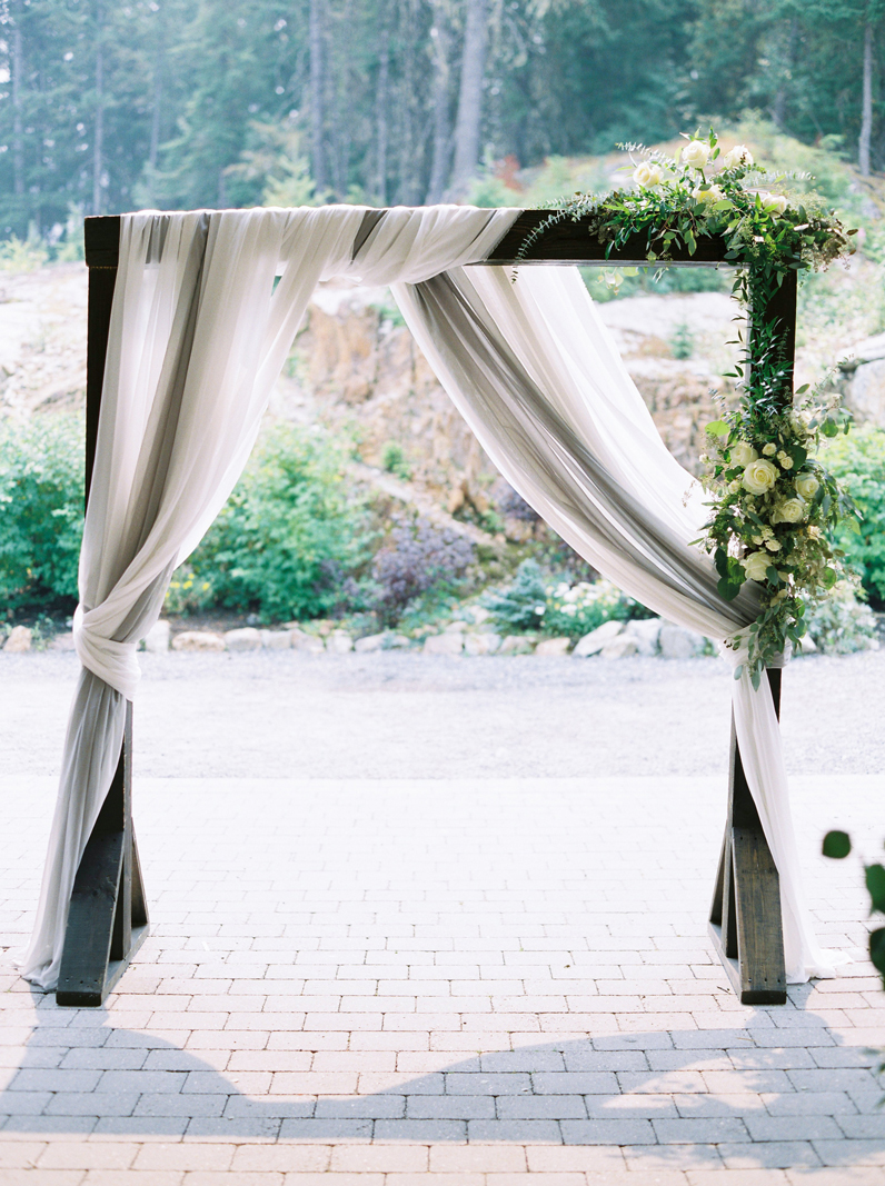 Ceremony arch by Bespoke Decor, where we collaborated to do their signage for a lovely wedding in Whistler.