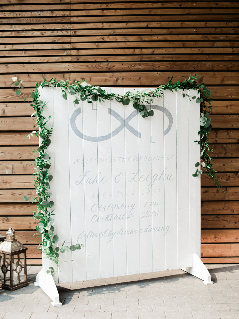 Wedding Signage with ruscus garland with light grey brush lettering by Liza Child Calligraphy and Design