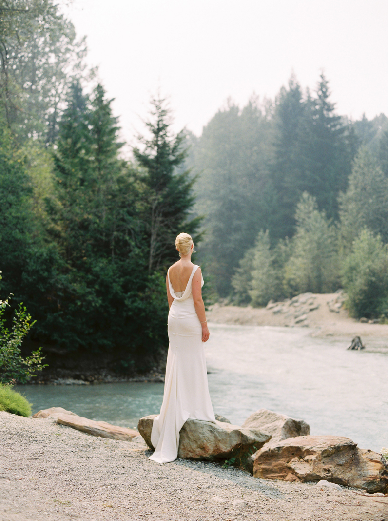 Leigha the beautiful bride staring into the forest in Whistler, BC
