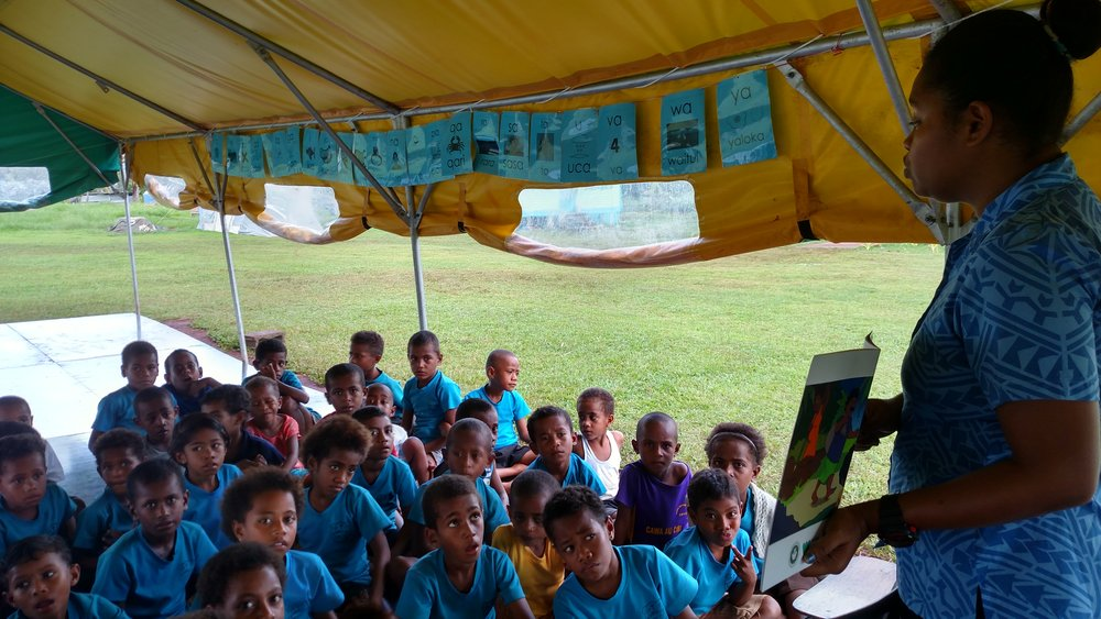 Rosi Batibasaga giving a lecture using Vula Vakaviti