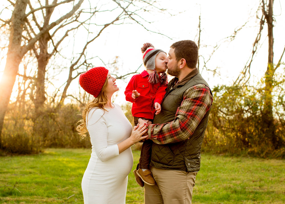 This family nailed it for their Christmas shoot with plenty of neutrals (cream, tan, browns and olive) with pops of a bright Christmas-y red.