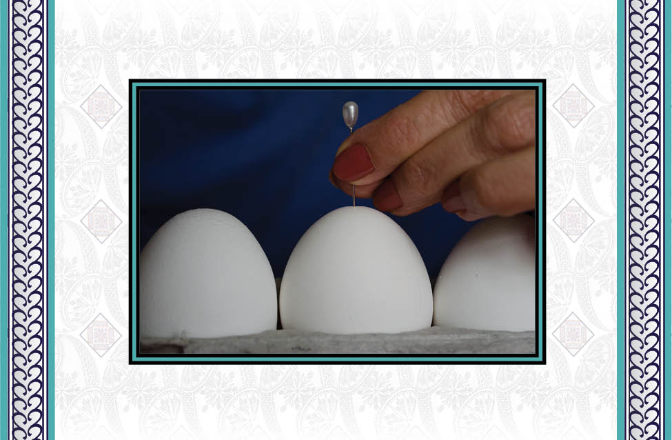 - Use the corsage pin to make a hole in the eggshell. This is easier than you might think. With the egg securely seated in the carton, push the pin through the shell at the top center point.