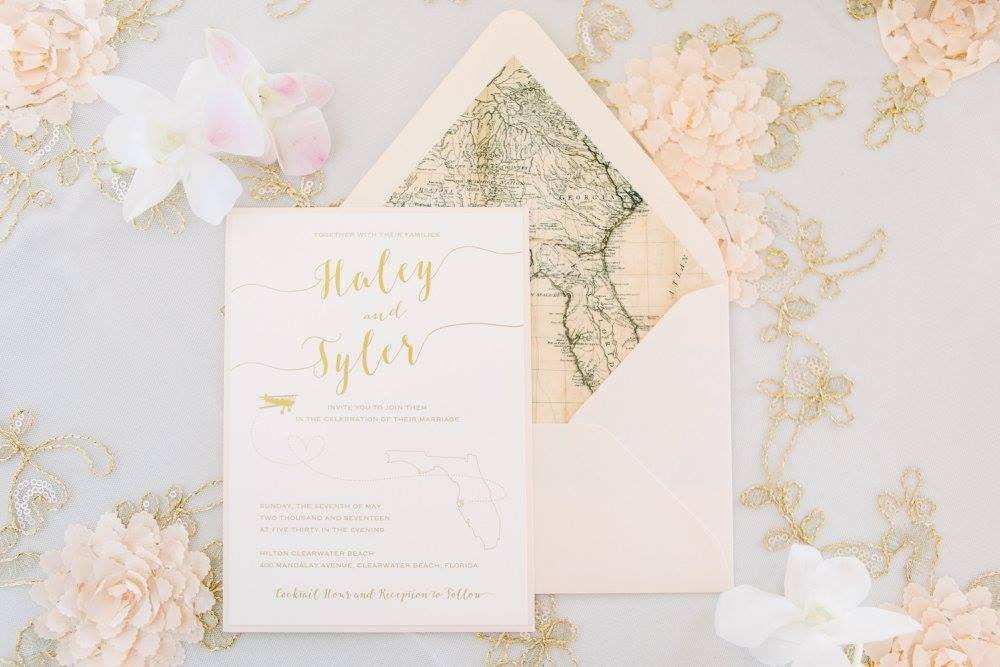 NAPLES - Featuring a Florida map envelope liner, fun script font and gold ink, this destination wedding invitation suite is sure to get your guests excited to fly away with you.  Customized to your destination.
