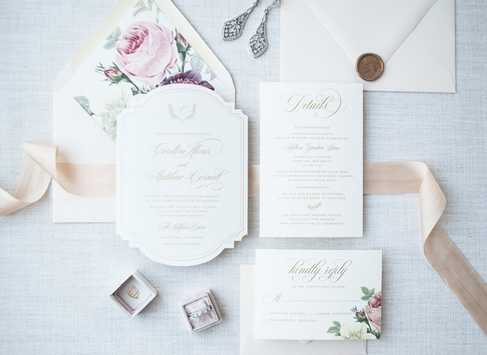 The Caroline - Inspired by Southern Plantation Weddings, the Carolina Suite features a beautiful vintage die cut shape, gold script and a delicate hand drawn wreath. Add a bold vintage floral envelope liner, wax seal and a lush silk ribbon to make this suite truly exceptional.