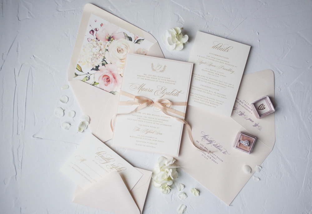 The Amelia - Timeless elegance, the Amelia invitation suite features rich gold text, a bold floral envelope liner and the most elegant script.