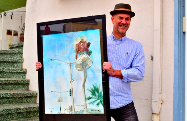 Artist Douglas Gorney holds a painting of the iconic Doggie Diner dachshund head that is located on a pedestal on Sloat Boulevard near the SF Zoo. Photos: Philip Liborio Gangi.