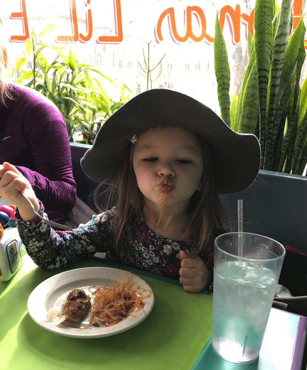 A girl with good taste. Enjoying the stir-fried glass noodles and a steak-mushroom dumpling.