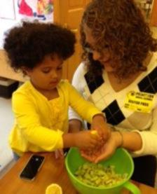 A RIDER INTERN WORKING WITH A CHILD IN OUR EARLY CHILDHOOD PROGRAM.