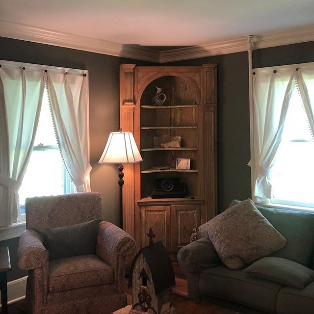 Check out these adorable linen panels with pom pom trim.  We hung them from antique drawer pulls-a unique solution to a challenging installation because of radiators and plumbing.  They really suit this cozy home, don't you think? @aandjinteriors #creatingcozyhomesforbusyfamilies