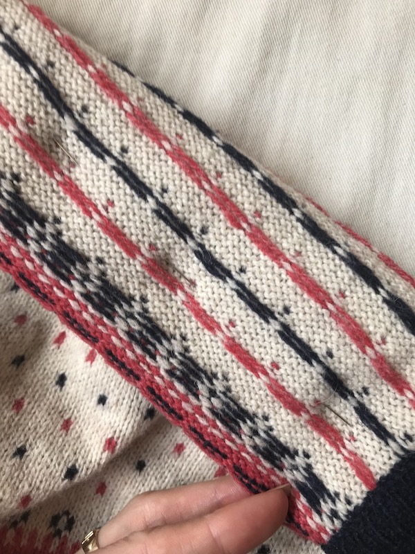 As you pin, ensure the pins line up with the knitting lines on  both  sides.