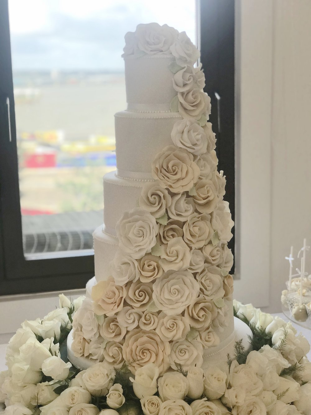 £895  Cascading Roses   Enquire