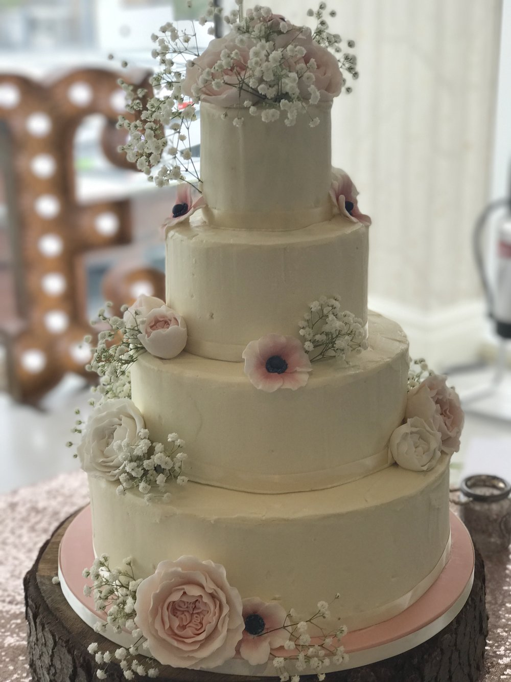 £650  Semi Naked Cake with Sugar Peonies   Enquire