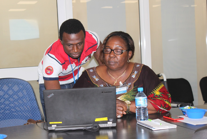 eHA's Samuel Aiyeoribe working with Ministry of Health Director Ifeoma Anagbagu during the training.