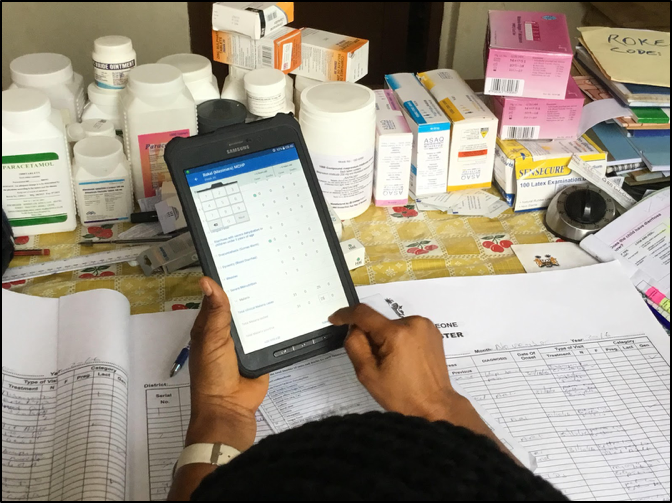 Healthcare worker utilizing eIDSR app