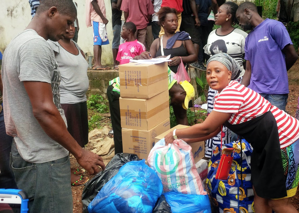 Western Freetown community members receiving and counting goods for the area distribution. Photo courtesy of Hawa Kombian.