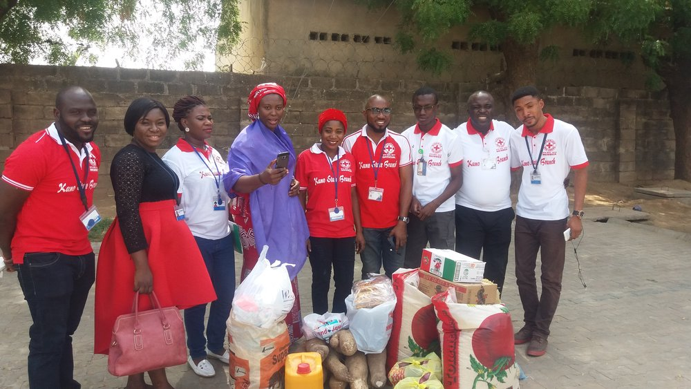 eHA Kano staff donating items.jpg