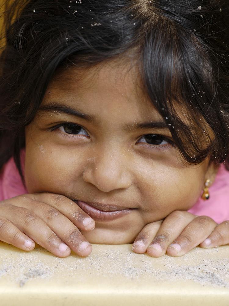 Smiling child in sandbox, 2009