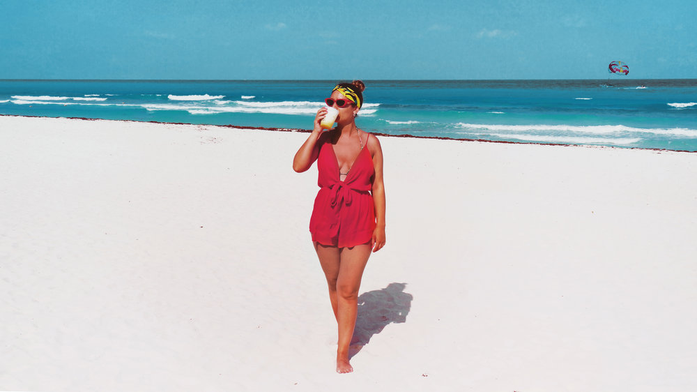 The tie front beach playsuit in red is sold out although it's still available in  black , but if you have your heart set on red  here's a similar one .