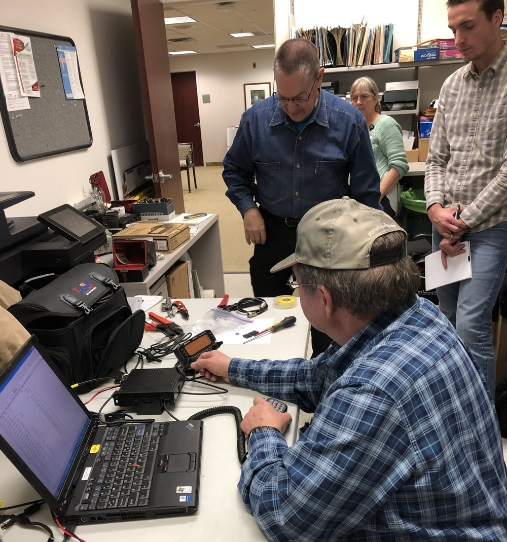 Gene, Paul, and John work on the system while our hospital contact keeps order.