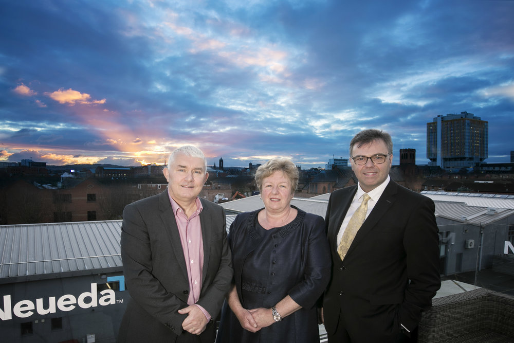 Brendan Monaghan, Neueda CEO with Helen Kirkpatrick, Neueda Chairman and Alastair Hamilton, Invest NI Chief Executive