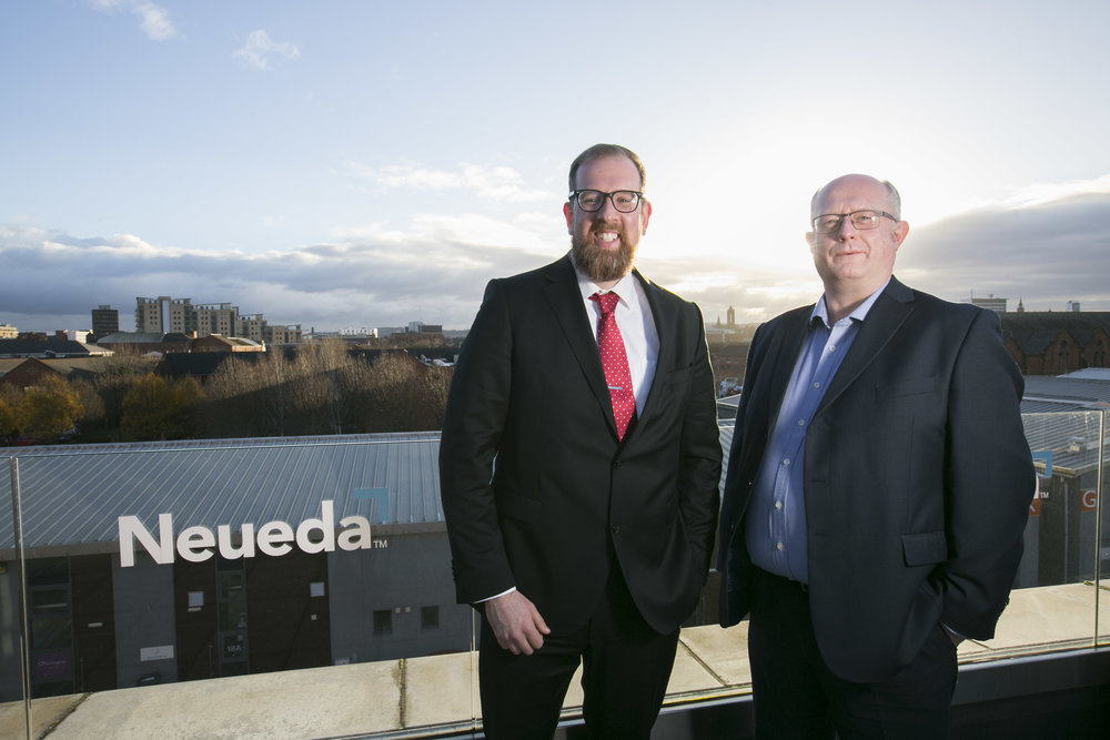 Paul Goddard, Channel and Partner Manager, IVI alongside Neueda's Head of Consulting, Neil McKeown.