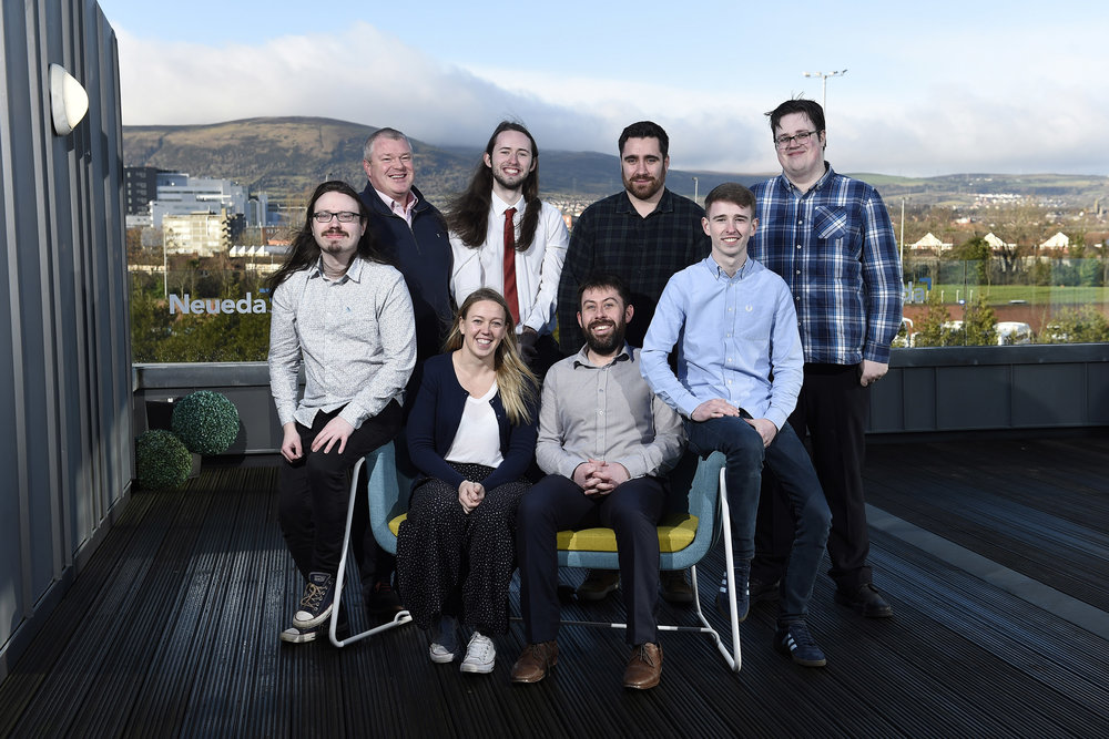 Tech Academy graduates and Neueda employees: Front Row (L-R) Christopher Foster, Lisa Sweeney (Neueda Head of People and Culture); Ryan McAuley; Donal Smyth; Back Row (L-R): Paddy O'Hagan (Neueda COO); Conor Pointon; Adam Clarke; Matthew Quigley.