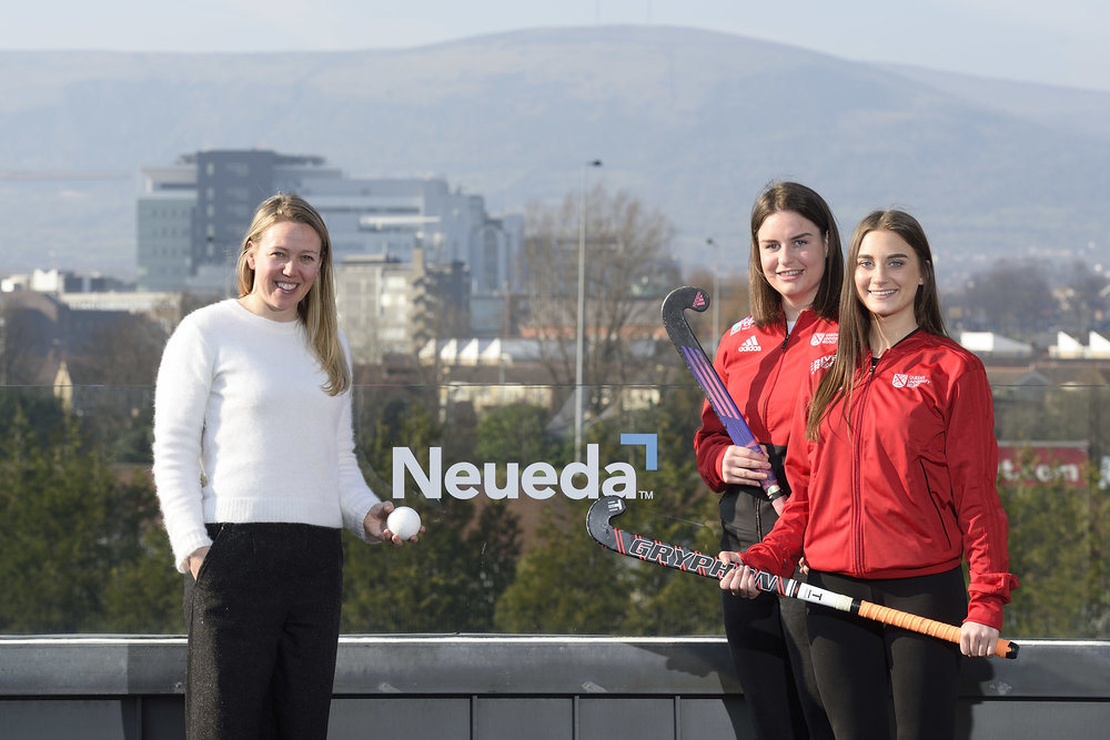 [L-R] Lisa Sweeney, Neueda, with Queen's hockey players Emily McStea and Erin Getty