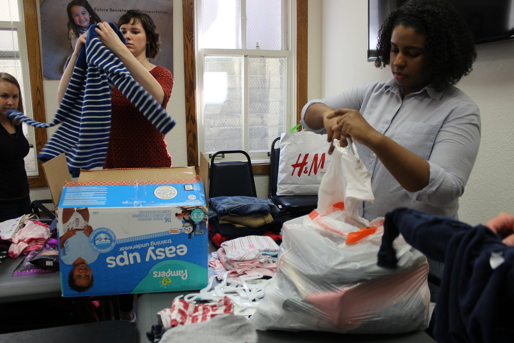 Yammer employees host and prepare a hygiene drive for Compass families.
