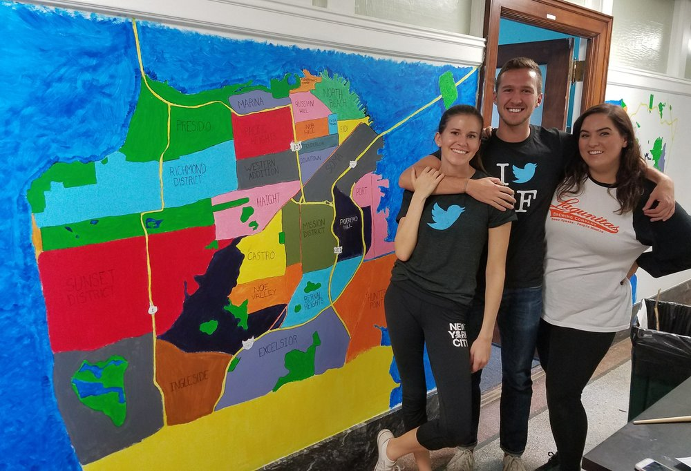 Twitter employees help paint a map to guide clients on the different districts in San Francisco.