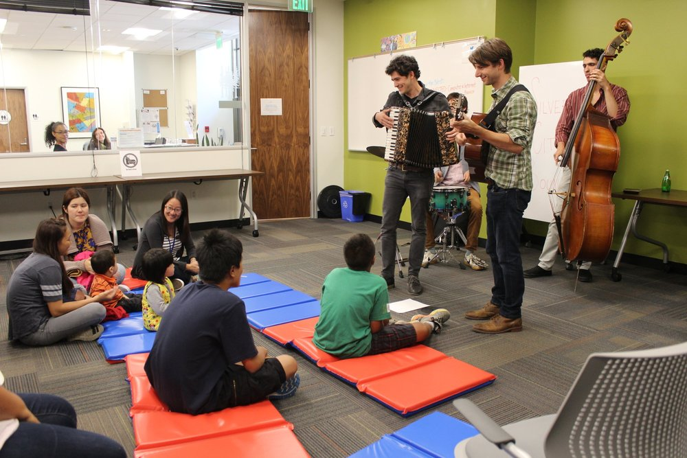Silver City Bound performs for families at the Twitter NeighborNest.