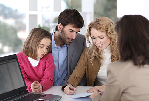 Family signing paper.jpg