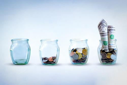 Jars of money growing.jpg
