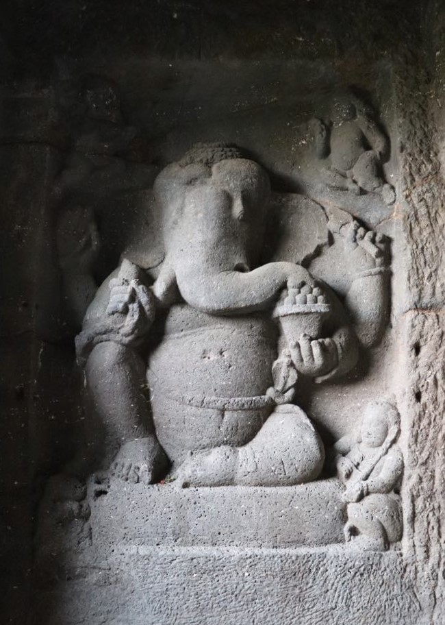 Ganesha hand-carved into an 8th century stone wall of the Ellora cave temples.