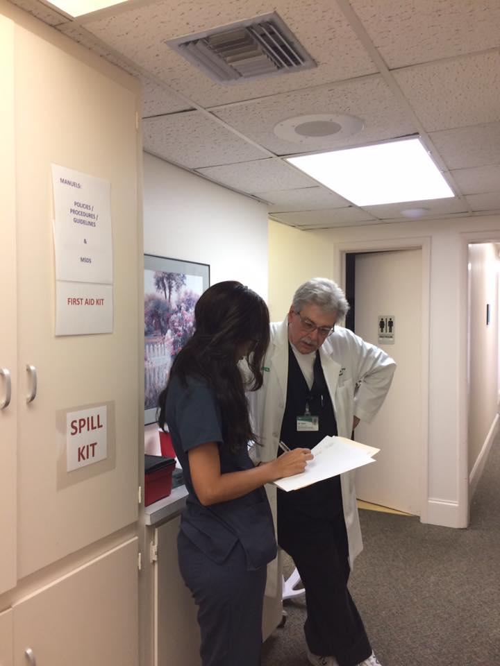nurse and doc talking.jpg