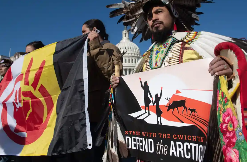 Native American leaders hold signs against drilling in the Arctic refuge outside the Capitol in Washington DC on 11 December. Photograph: Saul Loeb/AFP/Getty Images