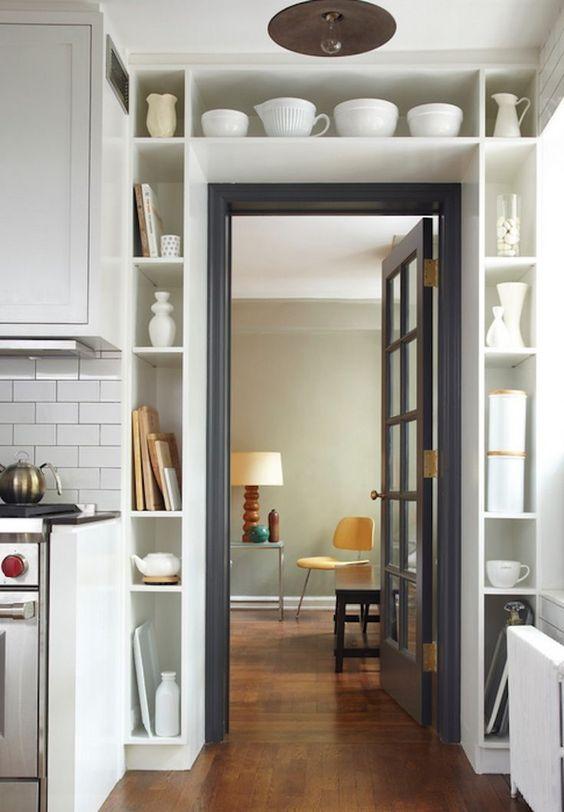 Built-in kitchen shelving around doorway.