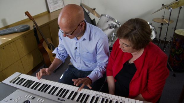06-a-music-therapist-works-with-a-patient-recovering-from-a-stroke.jpg