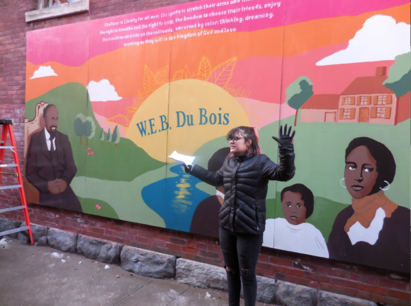 Railroad Street Youth Project intern Theresa Russell reads a statement about the mural. Photo: Terry Cowgill