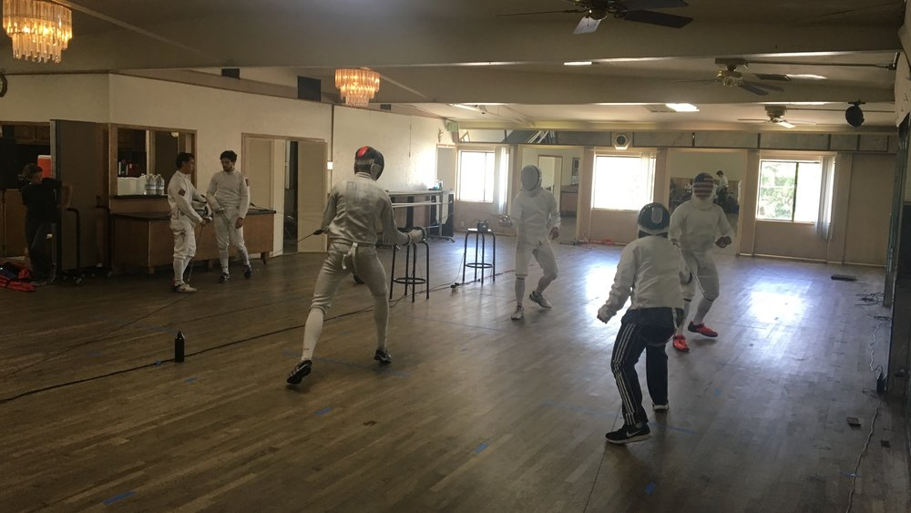 Epee Fencers enjoying the air conditioning and springy wooden floors of the Hollywood Dance Center
